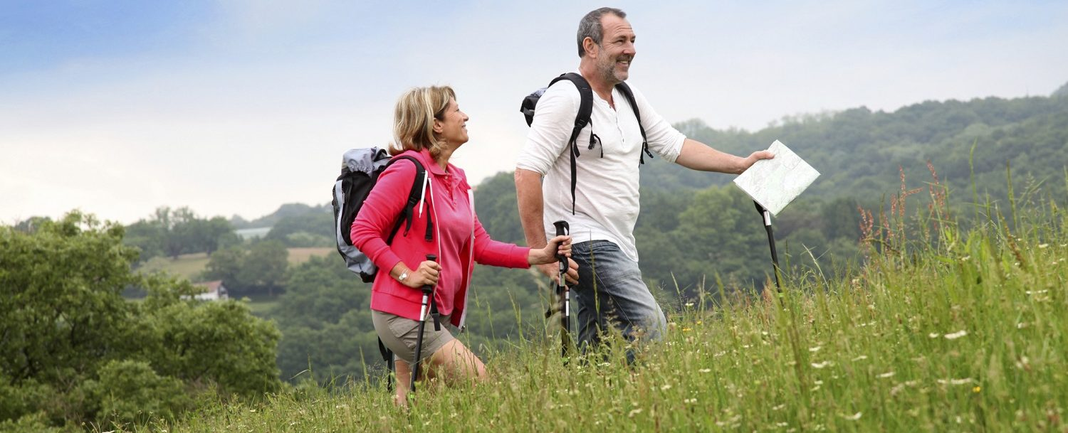 Couple hiking up a hill at Ward Pound Ridge Reservation