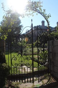 garden gate to one of the gorgeous but huge Greenwich, CT, mansions