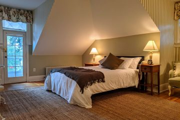 queen bed of Room 36, tucked under the gables of the Inn