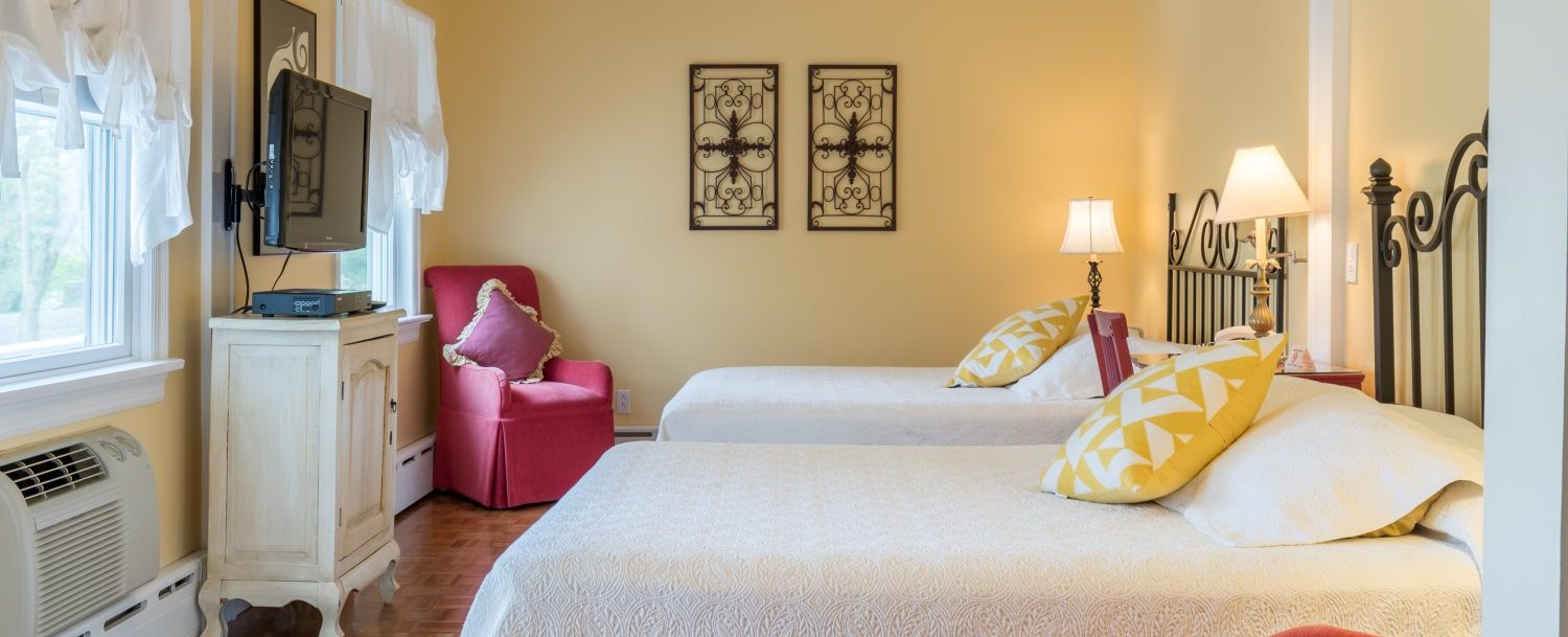 Two queen size beds in Room 23 at Stanton House Inn, a Greenwich, CT, bed and breakfast inn