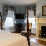 Fireplace, sitting area, TV in Room 27 at Stanton House Inn, a Greenwich, CT, bed and breakfast inn