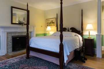 Queen size bed and fireplace in Room 28 at Stanton House Inn, a Greenwich, CT, bed and breakfast inn