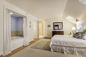 Sackett Suite, one of the Connecticut honeymoon suites at the Stanton House Inn in Greenwich, CT, features a king-size bed and whirlpool tub