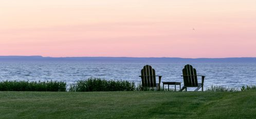adirondack chairs viewing long island sound at sunset on one of the best beaches near greenwich ct