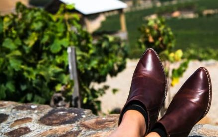 woman putting her feet up at one of the best wineries in CT
