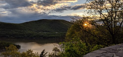 sunset over the hudson river from the road near bear mountain state park, one of the options for hiking trails near greenwich ct and nyc