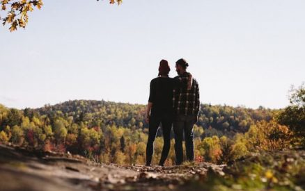 couple enjoying fall activities in CT like hiking to see CT fall foliage