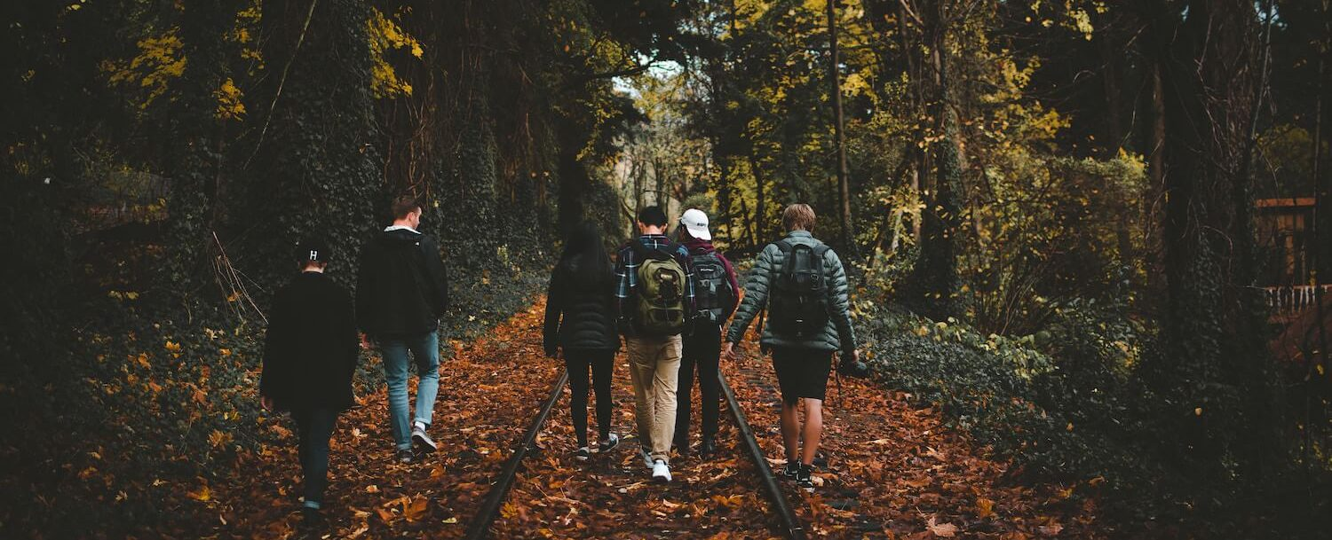 group hiking through fall foliage, a favorite of fall activities in CT