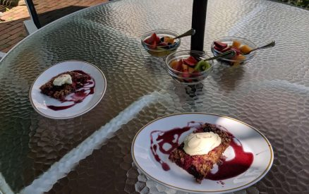New England Baked Berry Oats and fresh fruit for breakfast on Stanton House Inn's patio