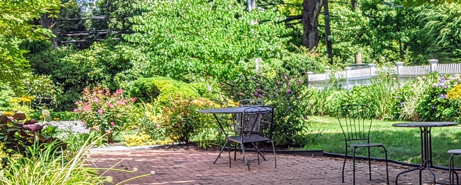 the outdoor patio of our breakfast cafe in downtown greenwich, ct, the perfect spot for sunday brunch