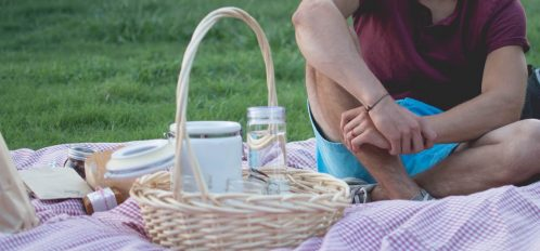 enjoying a picnic in a park, one of the romantic things to do in greenwich, ct