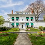 front of Stanton House Inn, a Greenwich, CT, inn, in the springtime