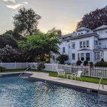 The pool of Stanton House Inn at sunset