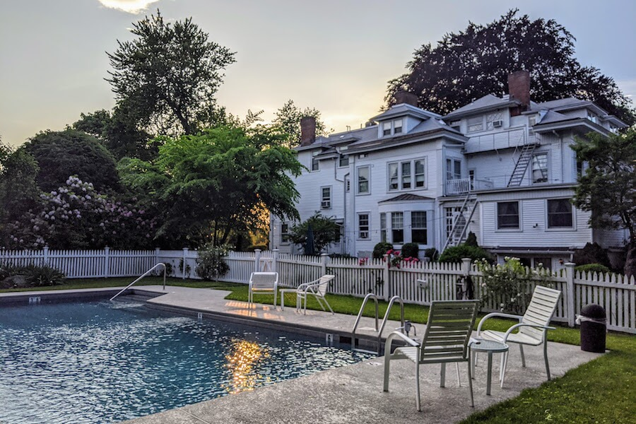 view of the outdoor pool at sunset at Stanton House Inn, a downtown Greenwich, CT, bed and breakfast inn