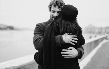 couple hugging along the coast of connecticut in winter