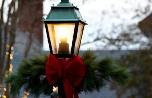 holiday decorations on lamposts; visiting cute towns in ct is one of the best things to do in connecticut in december