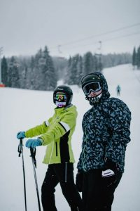 couple skiing at one of the best places to visit in CT during winter vacation getaways