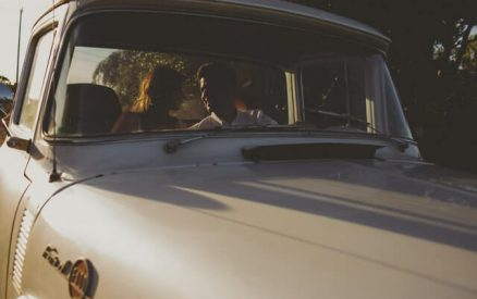 couple in an old timey car on a romantic road trip