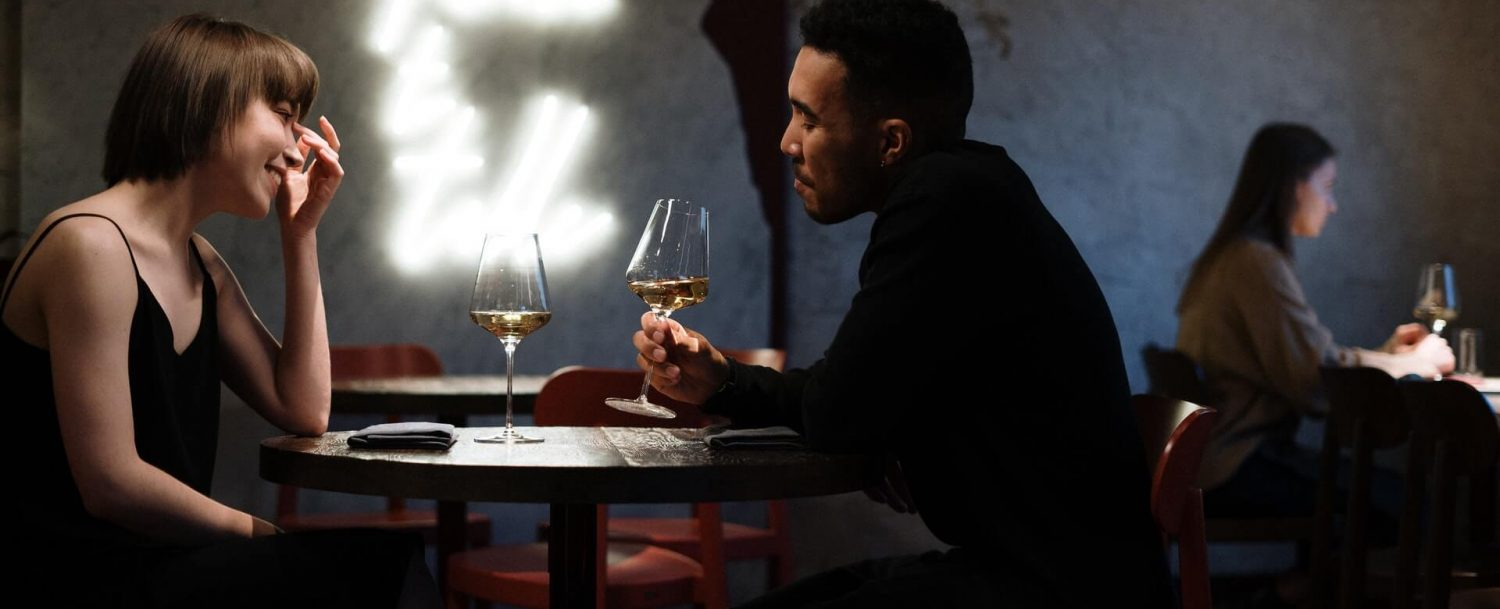couple enjoying a glass of wine at one of the most romantic restaurants in CT