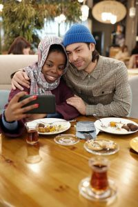couple taking a selfie over a romantic brunch