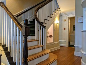 The grand staircase in the Front Hallway of Stanton House Inn