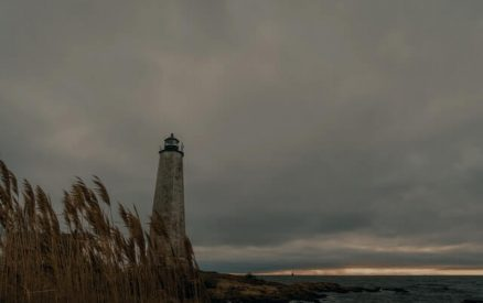 the lighthouse under a cloudy sky at lighthouse point park in new haven, connecticut