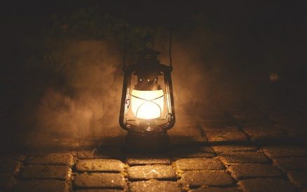 lantern on cobble stones during a Mystic ghost tour
