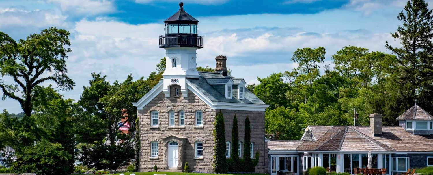 Morgan Point Light, a lighthouse near to Mystic, Connecticut. Sailing around the harbor is one of the best things to do in Mystic, CT