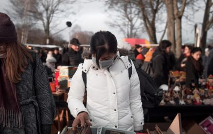 masked shopper at one of the flea markets in CT in winter
